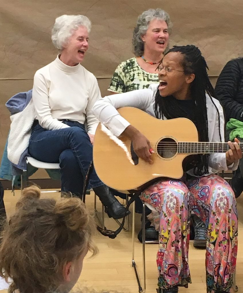 One Community image - Lea at Community Sing