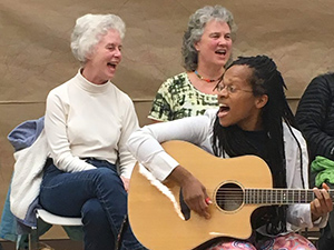 Lea leading a song at a Washington Revels Community Sing