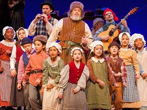 Steve Winick and the Children in the 2017 Christmas Revels
