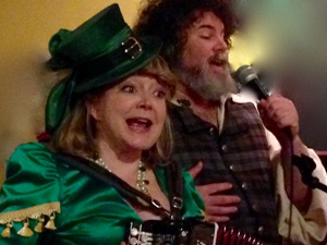 Jennifer Cutting and Steve Winick leading a Washington Revels Pub Sing